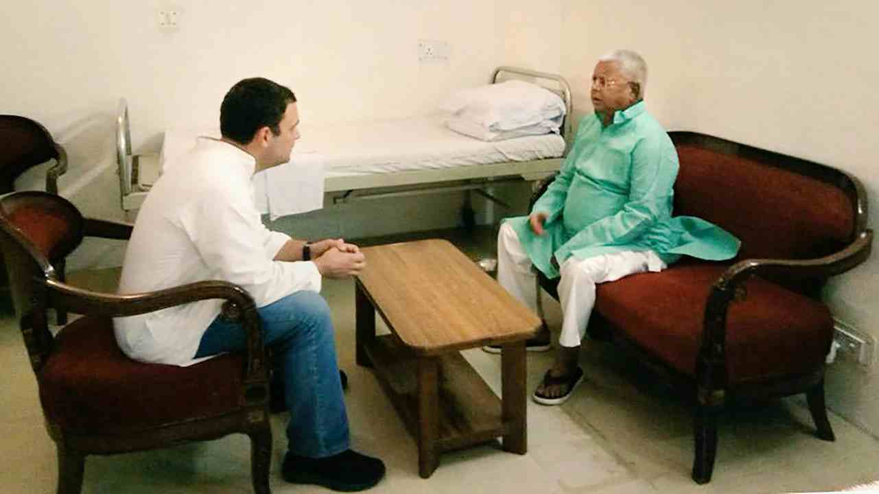 Congress President Rahul Gandhi meets RJD chief Lalu Prasad to inquire about his health at All India Institute of Medical Sciences (AIIMS) in New Delhi on Monday. (PTI)