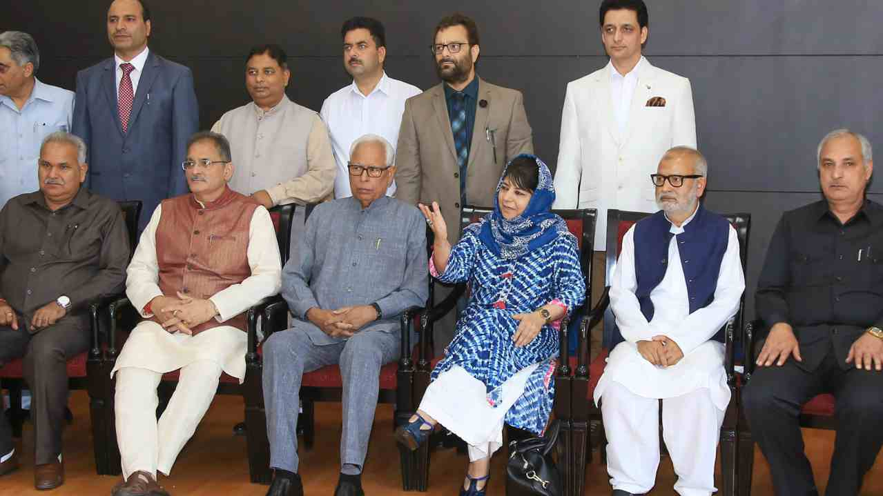 Jammu and Kashmir Governor NN Vohra and Chief Minister Mehbooba Mufti with Deputy Chief Minister Kavinder Gupta pose for a group photograph with the newly appointed minister after a reshuffle in Jammu on Monday. (PTI)