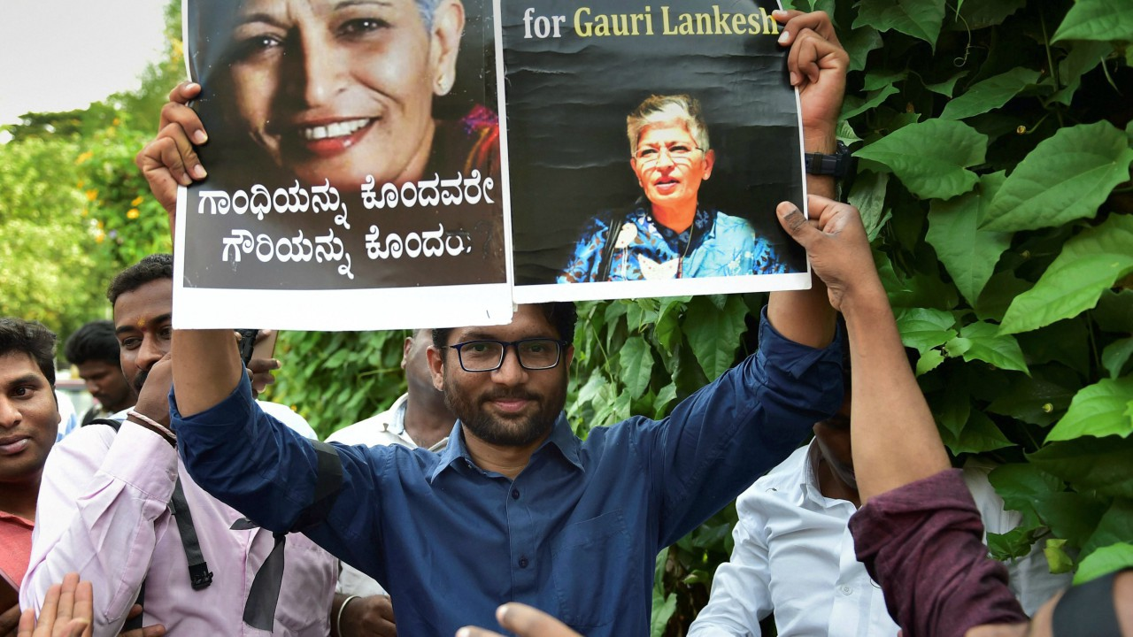 Dalit activist Jignesh Mevani holds a poster demanding justice for deceased journalist Gauri Lankesh during a protest, in Bengaluru. (PTI)