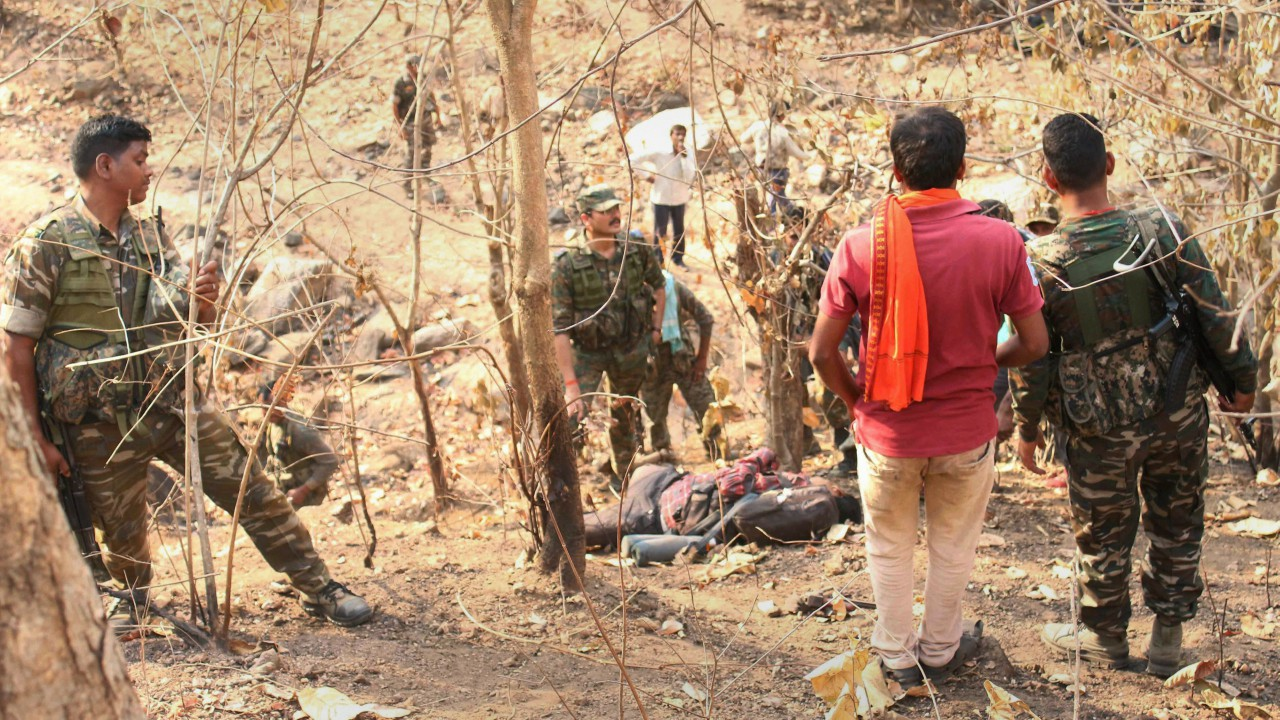 Security personnel carry out search in Kedu forest after five hardcore Maoists were gunned down by CRPF forces in an encounter, in Latehar district of Jharkhand. (PTI)