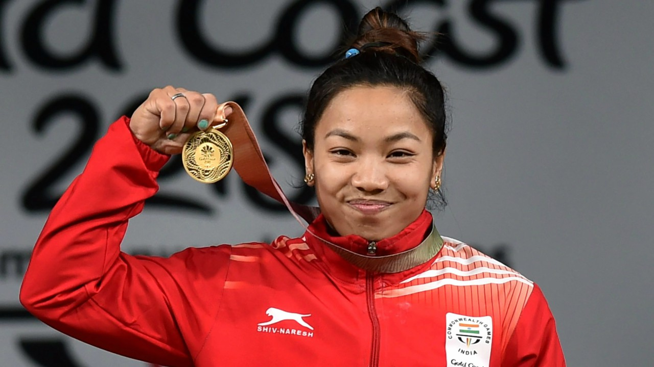 Gold medalist Indian weightlifter Chanu Saikhom poses for a photo during the medal ceremony of women's 48kg weightlifting event during the Commonwealth Games 2018 in Gold Coast. (PTI)
