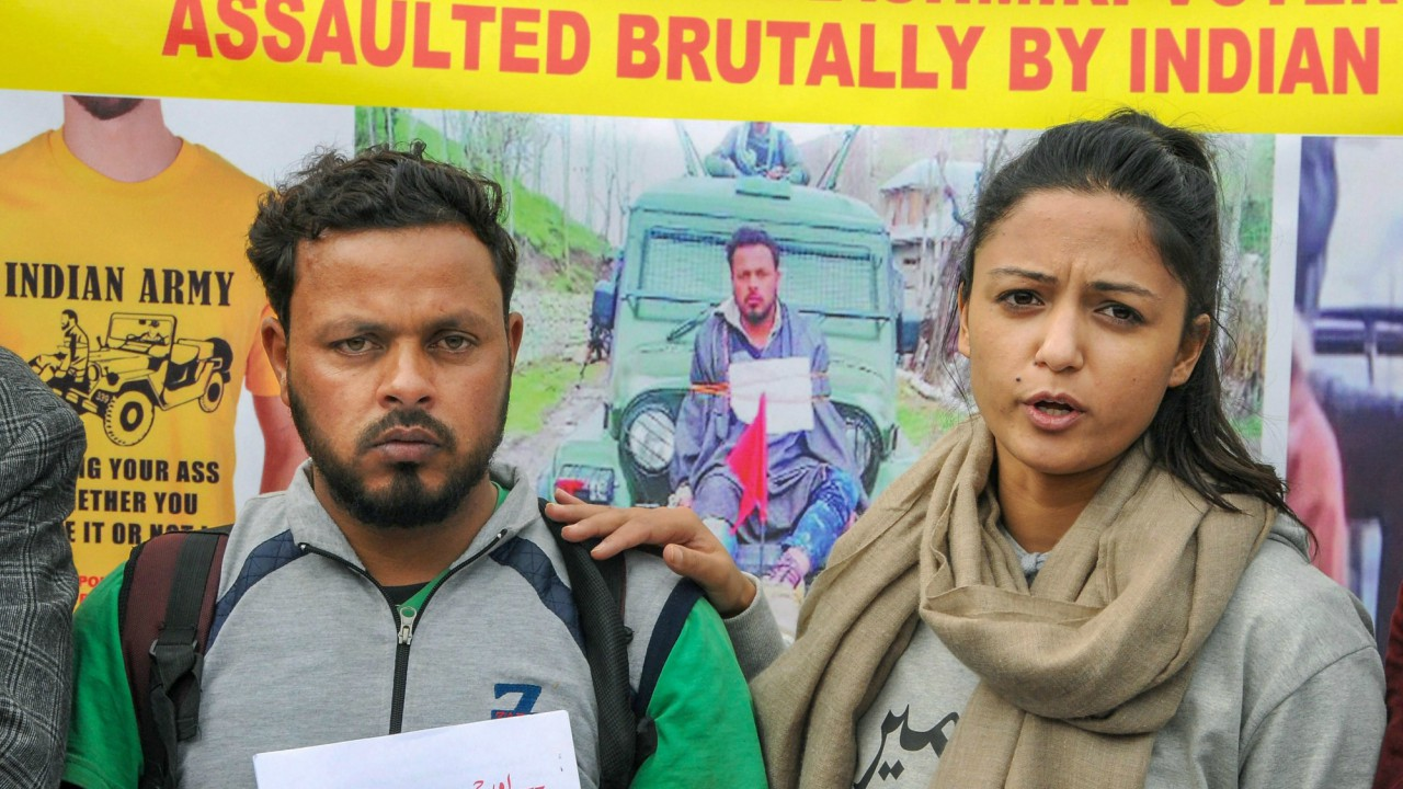 Embroidery artist used as a human shield by the Indian Army last year, Farooq Ahmed Dar, with former JNUSU vice-president Shehla Rashid release a report on the incident on its first anniversary, in Srinagar. (PTI)