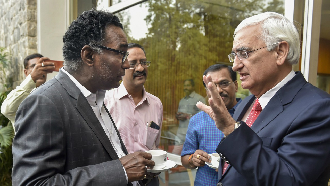 Supreme Court judge Justice Jasti Chelameswar talks to Congress senior leader Salman Khurshid during the book launch 'Appointment of Judges to the Supreme Court of India' in New Delhi. (PTI)