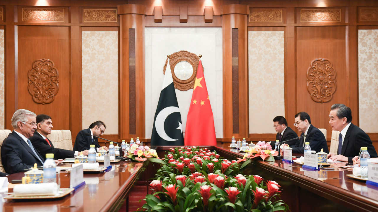 Pakistan's Foreign Minister Khawaja Muhammad Asif (left) and Chinese State Councilor and Foreign Minister Wang Yi (right) have a meeting at the Diaoyutai State Guest House in Beijing, China. (Reuters)