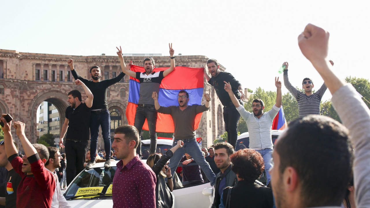People hold an Armenian national flag as they celebrate Armenian Prime Minister Serzh Sargsyan's resignation in Republic Square in Yerevan, Armenia. (AP/PTI)