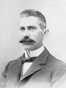 The person in the picture was a Scottish-born American Detroit-based inventor, best known for founding the X Company. He headed this company and its predecessor from 1899 until 1906, thereby helping to create one of the most successful nameplates in United States motor vehicle history. Known for his inventions like lawn sprinkler. Identify the person in the picture?