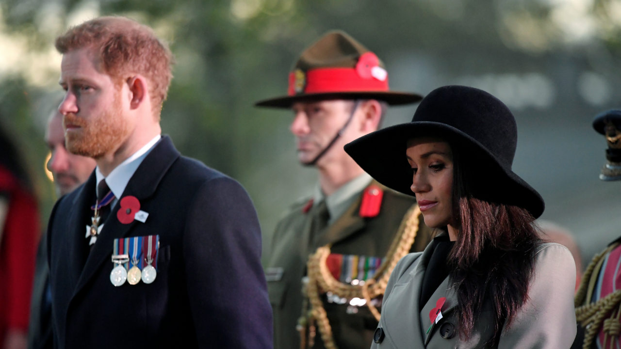 Britain's Prince Harry and his fiancee Meghan Markle attend the Dawn Service at Wellington Arch to commemorate Anzac Day in London, Britain. (Reuters)