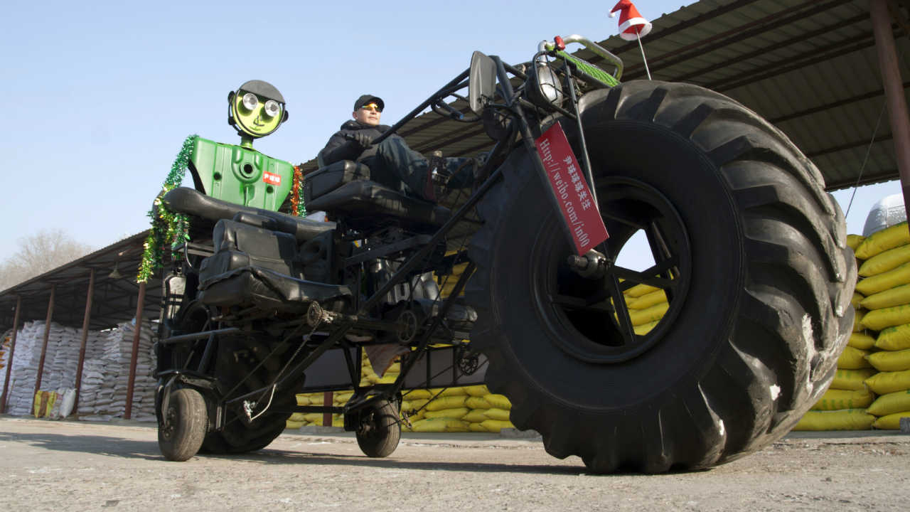 Monster truck -- Zhang Yali, 49, made this giant bicycle with his friends. It is 3.2-metre-high and 5.5-metre-long and seats three people. It weighs over one tonne, cost Zhang more over 20,000 yuan (USD 3,156 ). Zhang spent two months making this bike as a gift for his son. (REUTERS)