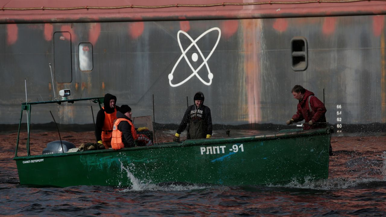 Fishermen sail past the floating nuclear power plant. (Image: Reuters)