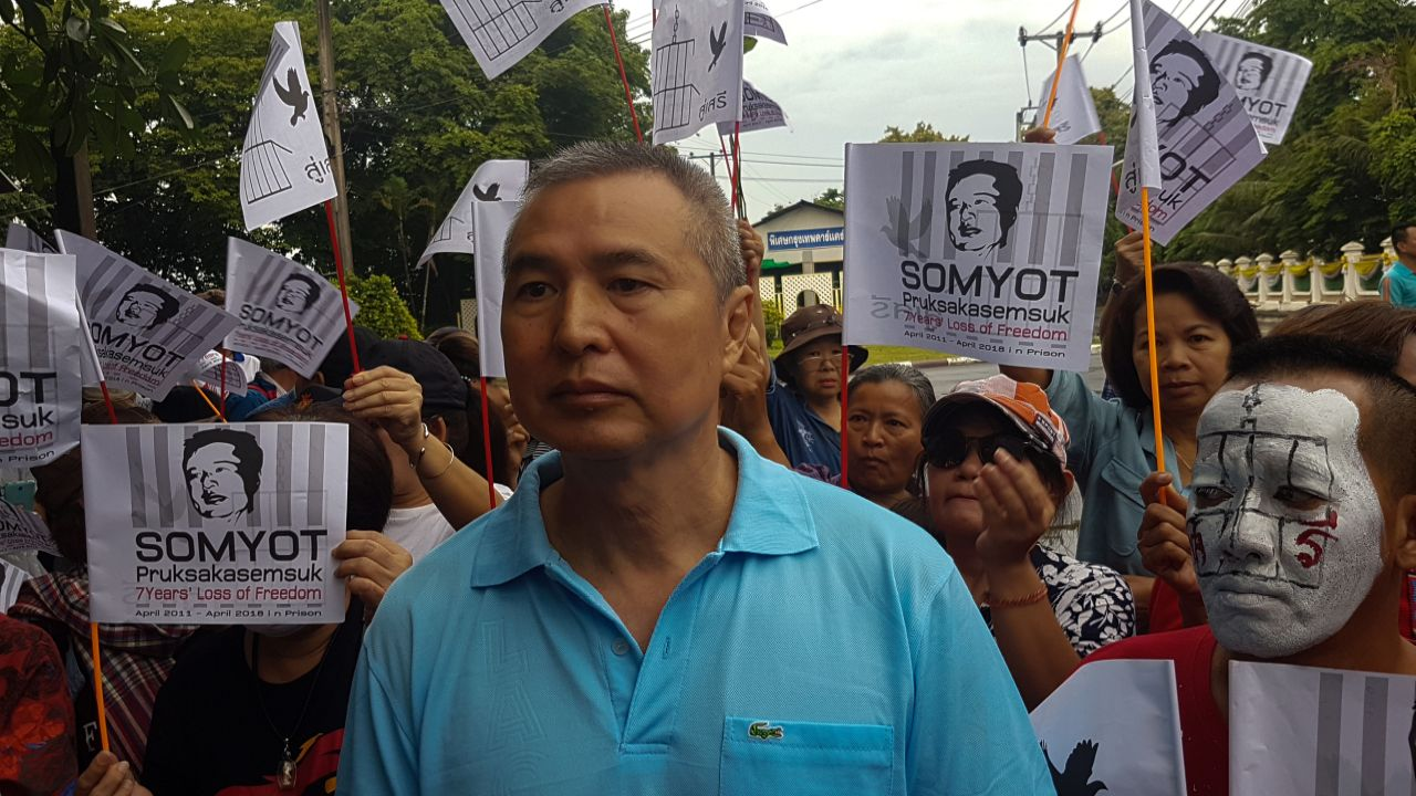 Somyot Prueksakasemsuk, 56, a high-profile Thai activist and former magazine editor jailed for insulting the country's monarchy, stands next to his supporters after his release from a Bangkok prison in Thailand. (Reuters)