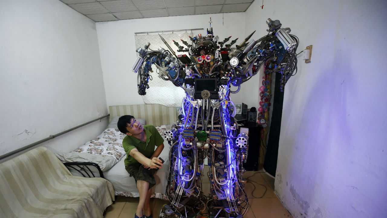 "The robot was invented by Tao Xiangli. It can be controlled a remote controller. The self-taught Chinese inventor built the home-made robot, named ""The King of Innovation"", out of scrap metal and electronic wires that he bought from a second-hand market. Tao completed his creation in less than a year, with costs of production and living expenses amounting to 300,000 yuan (USD 49,037). The robot, measures 2.1 metres (6.9 feet) in height and 480 kg in weight. It turned out to be too tall and heavy to walk out of the front door of his house. It can perform simple movements with its hands and legs and also mimic human voices. (REUTERS)"