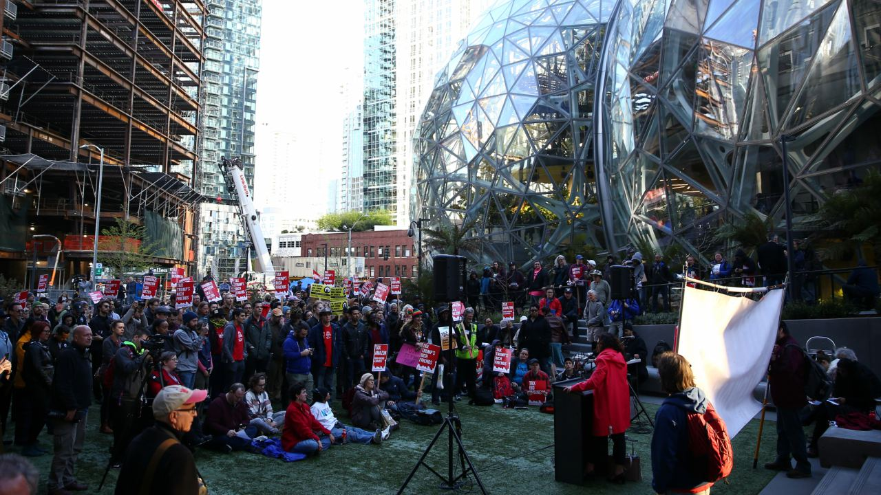 People gather to protest in front of the Amazon Spheres to demand that the city of Seattle tax the largest corporations to help fund affordable housing, according to organizers, in Seattle, Washington, US. (Image: Reuters)
