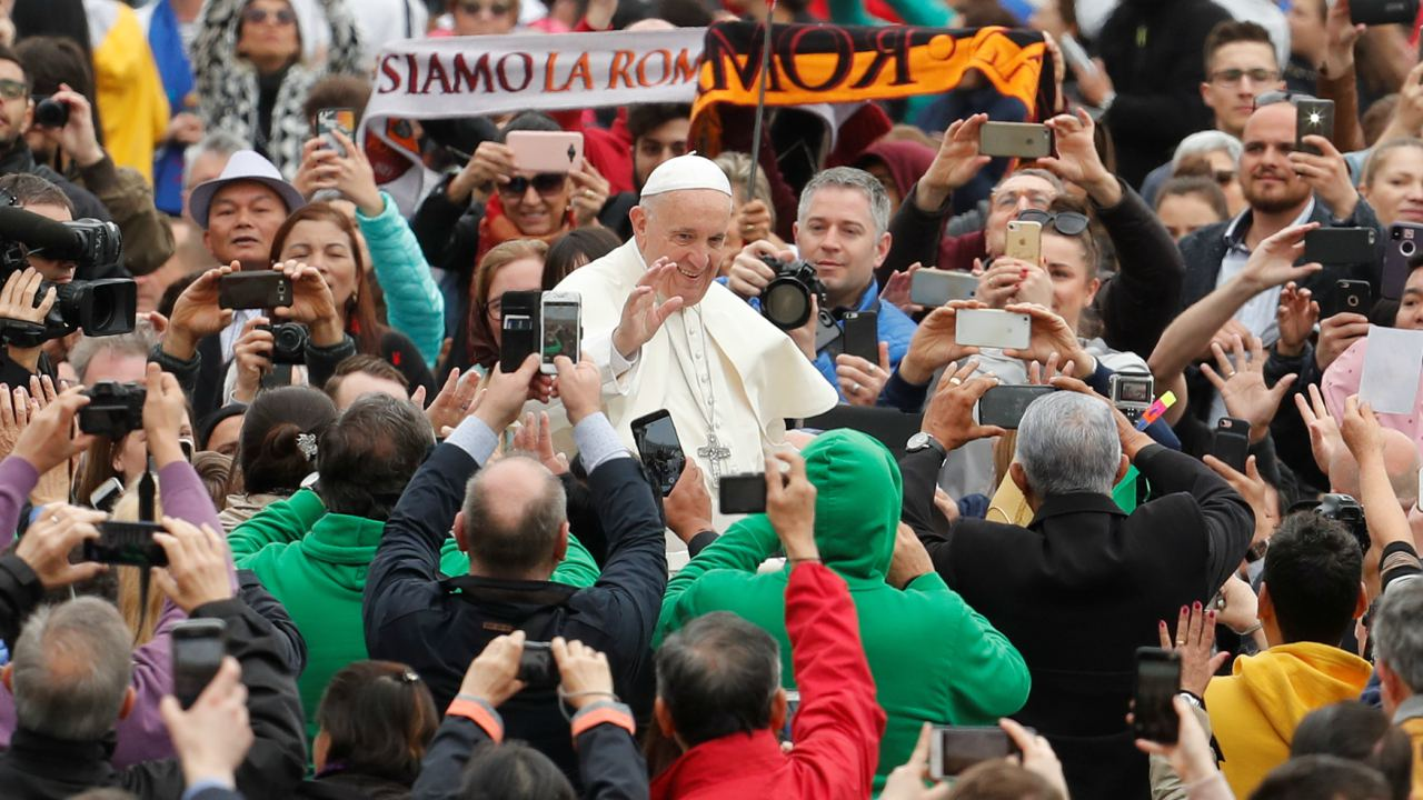 Pope Francis waves as he arrives to lead the Wednesday general audience in Saint Peter's square at the Vatican. (Image: Reuters)
