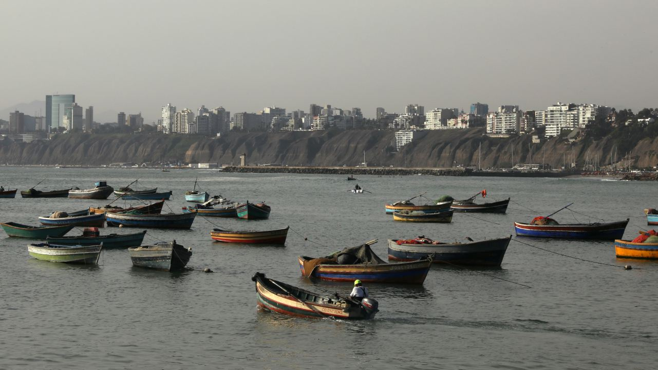 Fishing boats are seen at Pescadores beach in the Chorrillos district of Lima, Peru. (Image: Reuters)