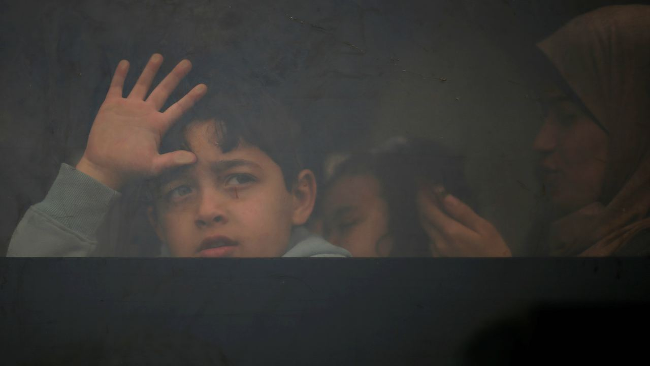 A Palestinian boy looks out a bus window as he waits to travel into Egypt, after the Rafah border crossing was opened for three days for humanitarian cases, in the southern Gaza Strip. (Image: Reuters)