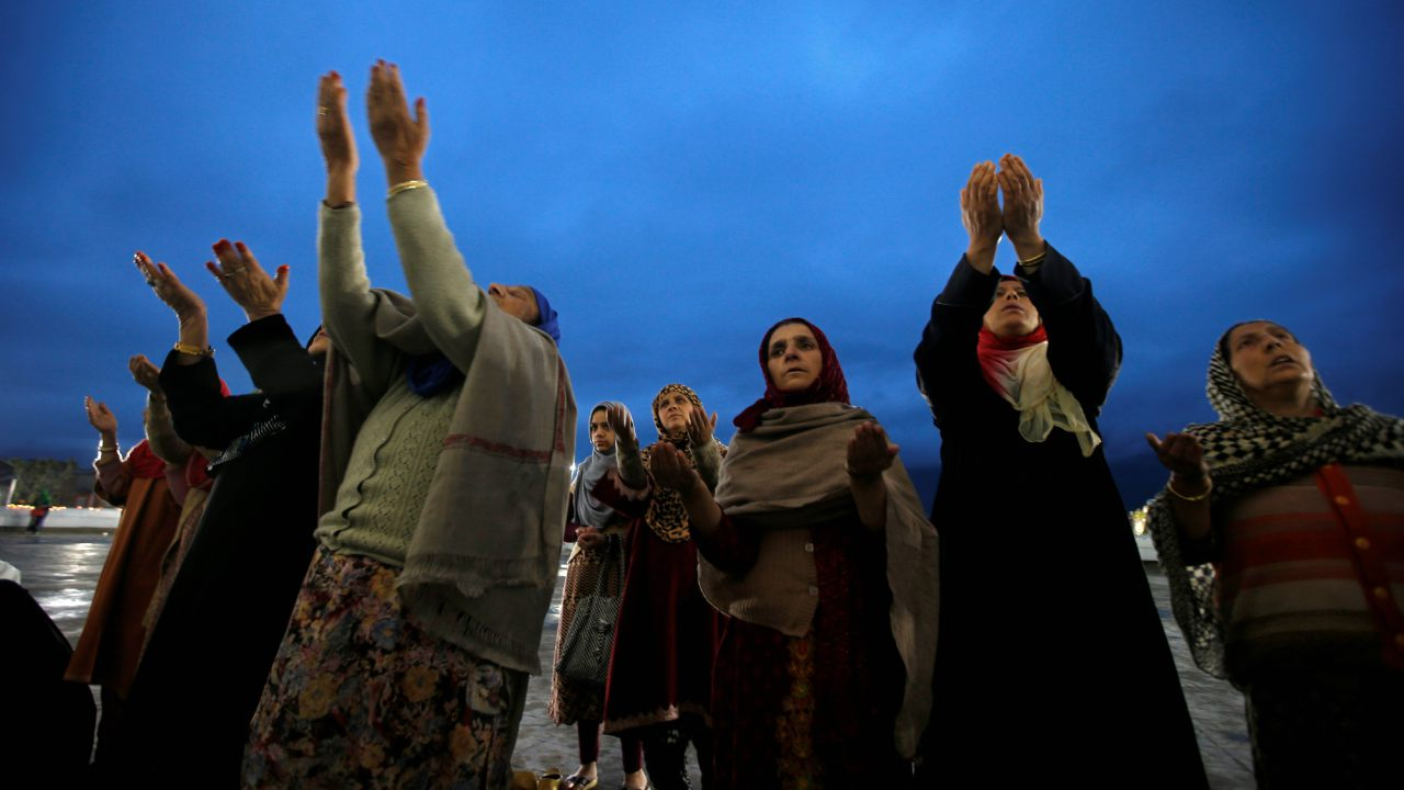 Kashmiri Muslim women pray on the Friday following for Meeraj-un-Nabi, a festival which marks the ascension of Prophet Mohammed to Heaven, at the Hazratbal shrine early morning in Srinagar. (Image: Reuters)