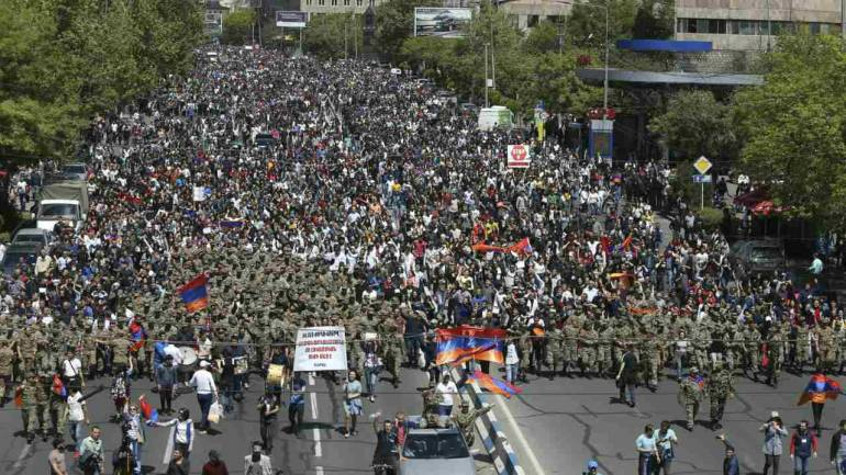 People march during a protest against the appointment of ex-president Serzh Sarksyan as the new prime minister in Yerevan, Armenia. (REUTERS)
