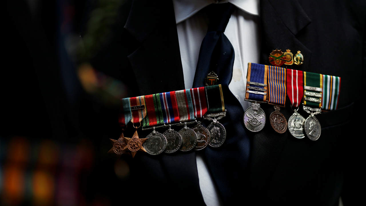 Former servicemen wearing medals show up at the Cenotaph to pay their respects on Anzac Day in Sydney, Australia. (REUTERS)