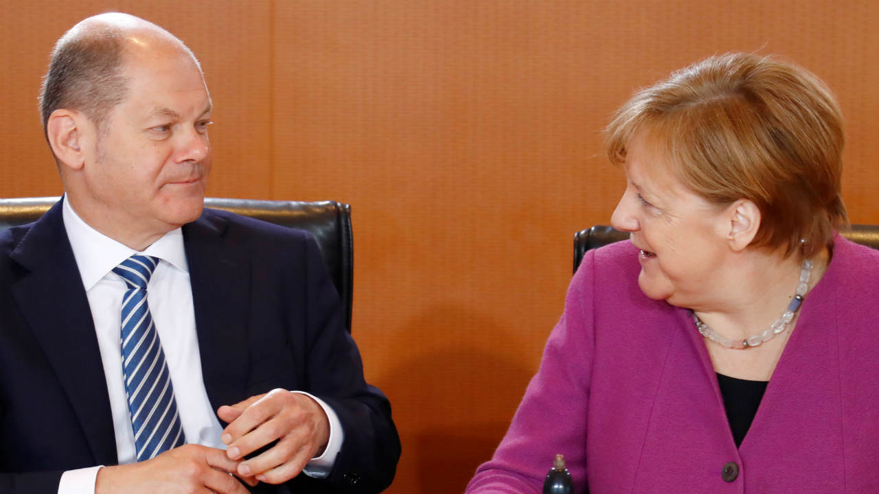 German Chancellor Angela Merkel and Finance Minister and vice-chancellor Olaf Scholz attend the weekly cabinet meeting in Berlin, Germany. (REUTERS)