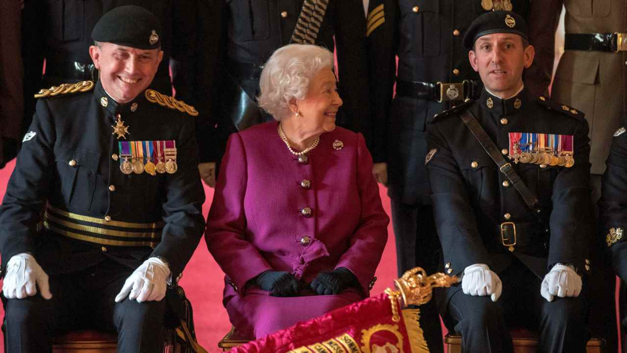 Britain's Queen Elizabeth, Colonel-in-Chief of the Royal Tank Regiment, poses for a photograph after presenting the regiment with their new standard in St George's Hall at Windsor Castle in Windsor, Britain. (Reuters)