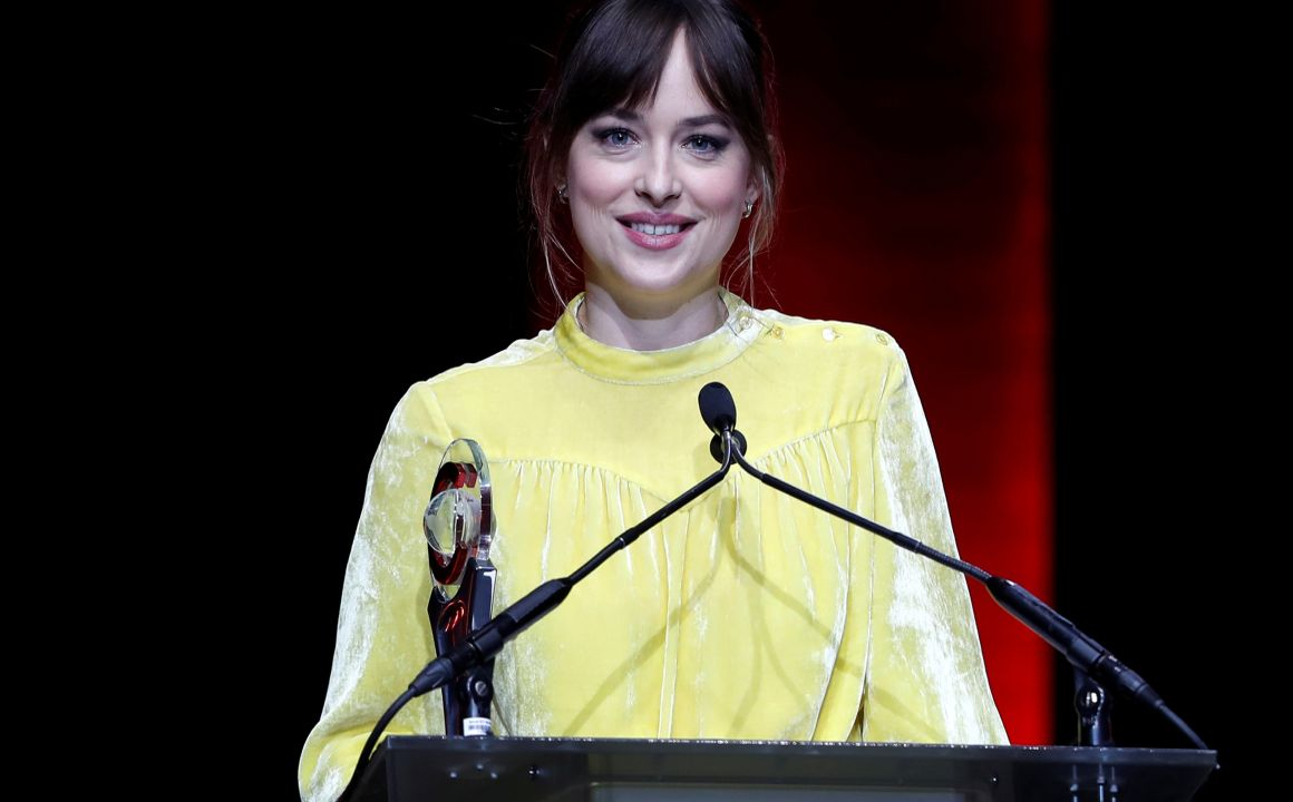 Dakota Johnson accepts the award for Female Star of the Year award during the CinemaCon Big Screen Achievement Awards in Las Vegas. (Reuters)
