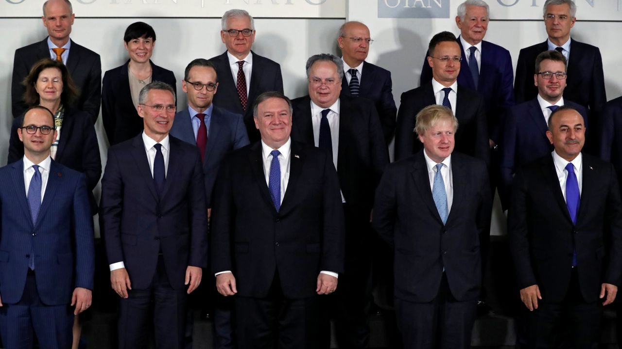 NATO Secretary General Jens Stoltenberg, US Secretary of State Mike Pompeo and Britain's Foreign Secretary Boris Johnson pose for a group photo at a NATO foreign ministers meeting at the Alliance's headquarters in Brussels, Belgium. (Reuters)