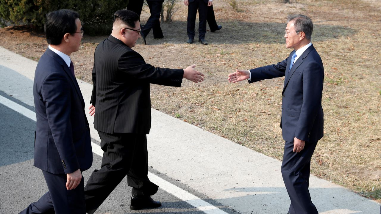 South Korean President Moon Jae-in and North Korean leader Kim Jong Un shake hands at the truce village of Panmunjom inside the demilitarized zone separating the two Koreas. (Reuters)