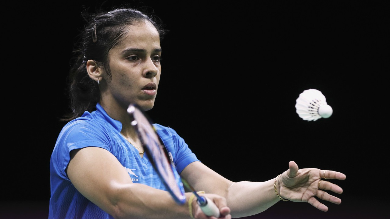 Saina Nehwal | Nehwal wins gold in women's singles after defeating P V Sindhu in the final match. Sindhu settles for silver.