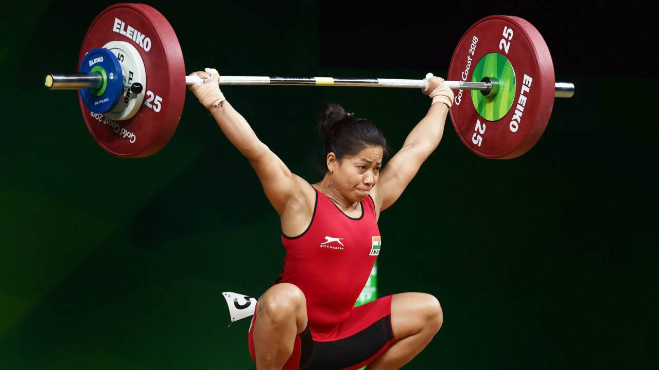 Sanjita Chanu Khumukcham | Dominating the 53 kg event, another Manipuri girl got India their second gold medal. On the way to the podium she crushed the existing Games record lifting 84kg in Snatch. The 5-feet athlete stood tall to lift another 108kg in Clean and Jerk, finishing with 192kg, 10kg more than the silver medallist.