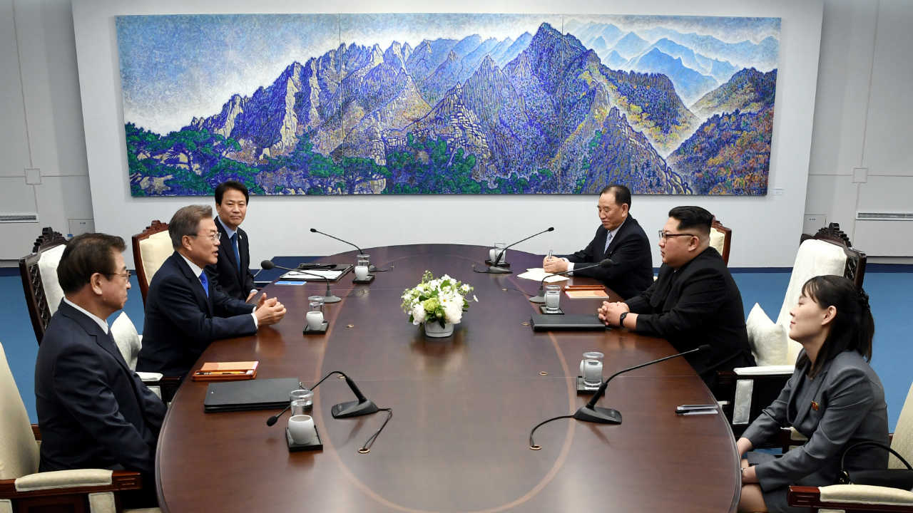 Moon and Kim along with others holding talks. (Image: Reuters)