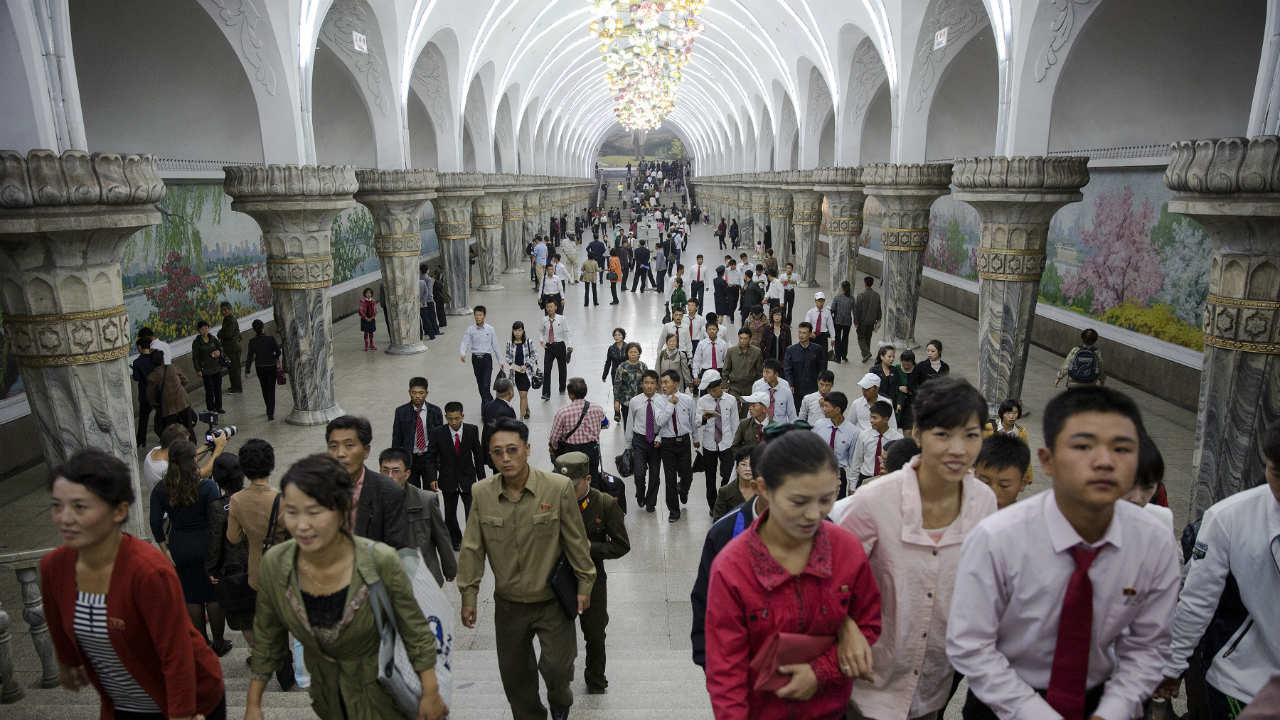 Commuters make their way through a subway station visited by foreign reporters during a government organized tour in Pyongyang, North Korea. (Photo: Reuters)
