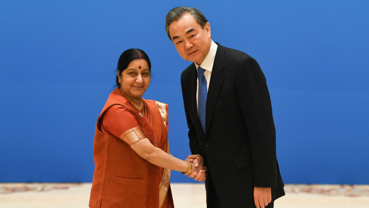 Foreign Minister Sushma Swaraj shakes hands with Chinese State Councilor and Foreign Minister Wang Yi before a meeting of foreign ministers and officials of the Shanghai Cooperation Organisation (SCO) at the Diaoyutai State Guest House in Beijing, China. (Reuters)