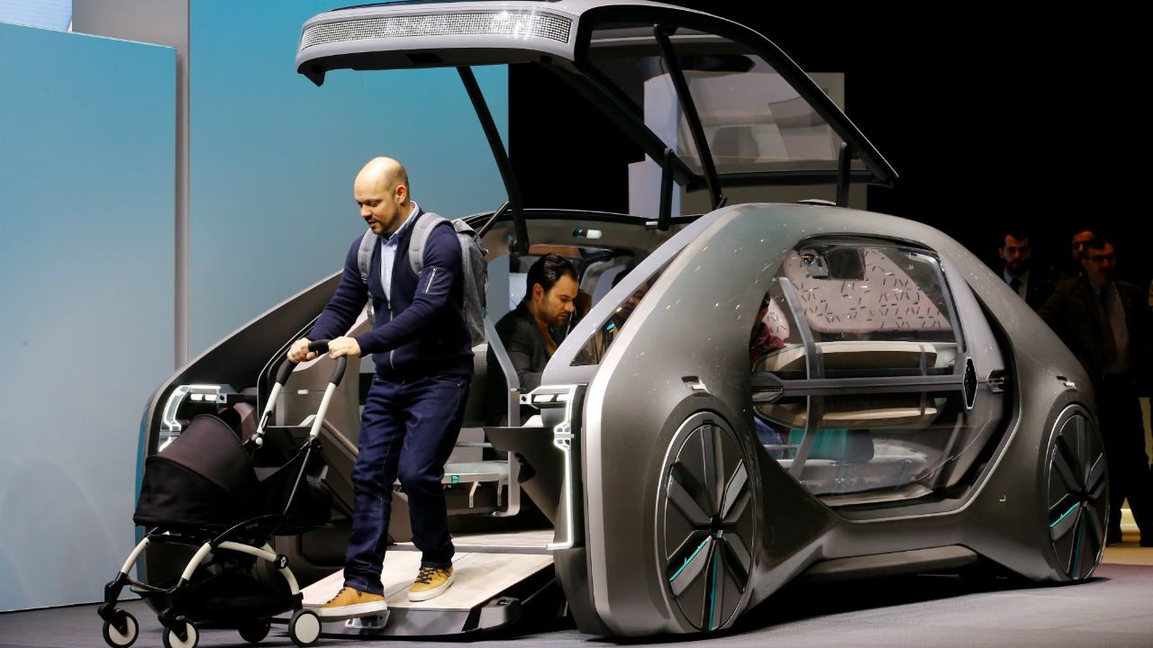 Renault EZ-GO | The French car maker unveiled this concept of a futuristic autonomous taxi. The vehicle can accommodate six people and has a step-free access. (Image: Reuters)