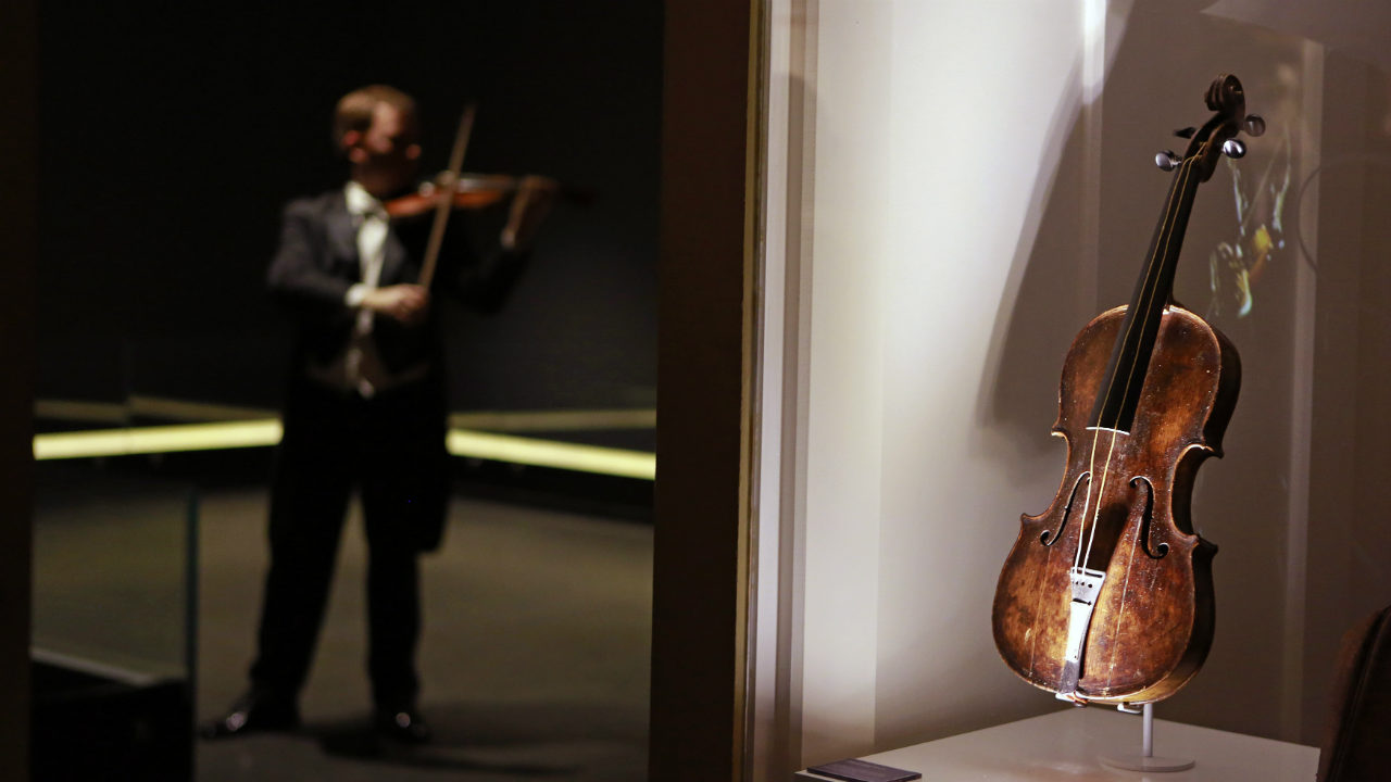 """Pictured here is the violin that belonged to Titanic bandmaster Wallace Hartley, seen on display at Titanic Belfast. It is often thought that """"Nearer, My God, To Thee"""" is the last song the band played. But some historians dispute it. (Photo: Reuters)"""