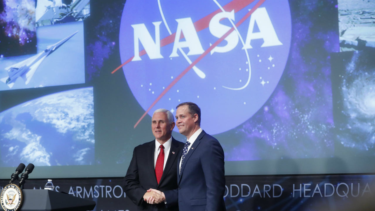 Vice President Mike Pence, left, shakes hands with the new NASA administrator Jim Bridenstine, right, on stage during a swearing-in ceremony. (AP/PTI)