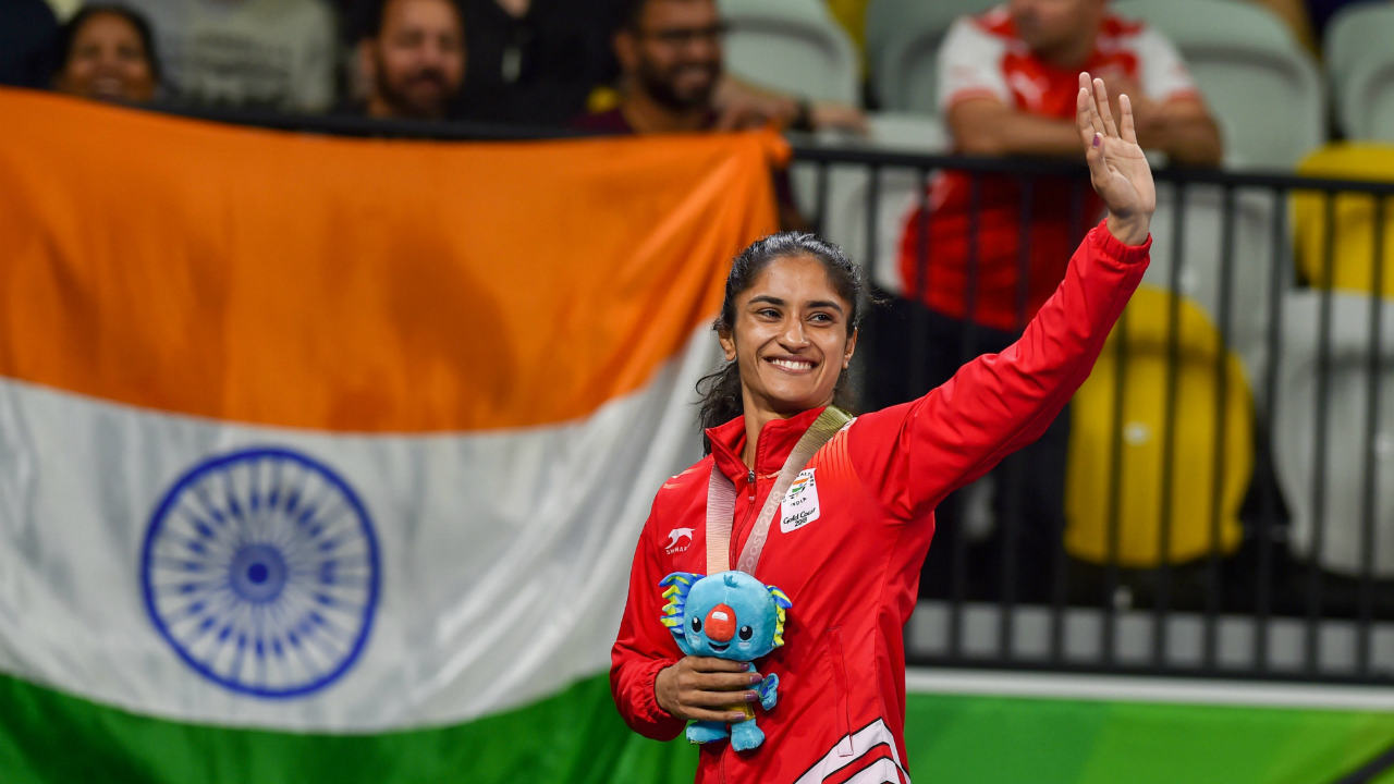 Vinesh Phogat | Phogat waves during the medal ceremony of Women's 50kg wrestling Nordic in Gold Coast, on Saturday. (Image: PTI)