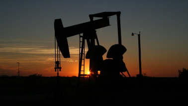 Oil prices edge up on surprise drawdown in US crude stockpiles
