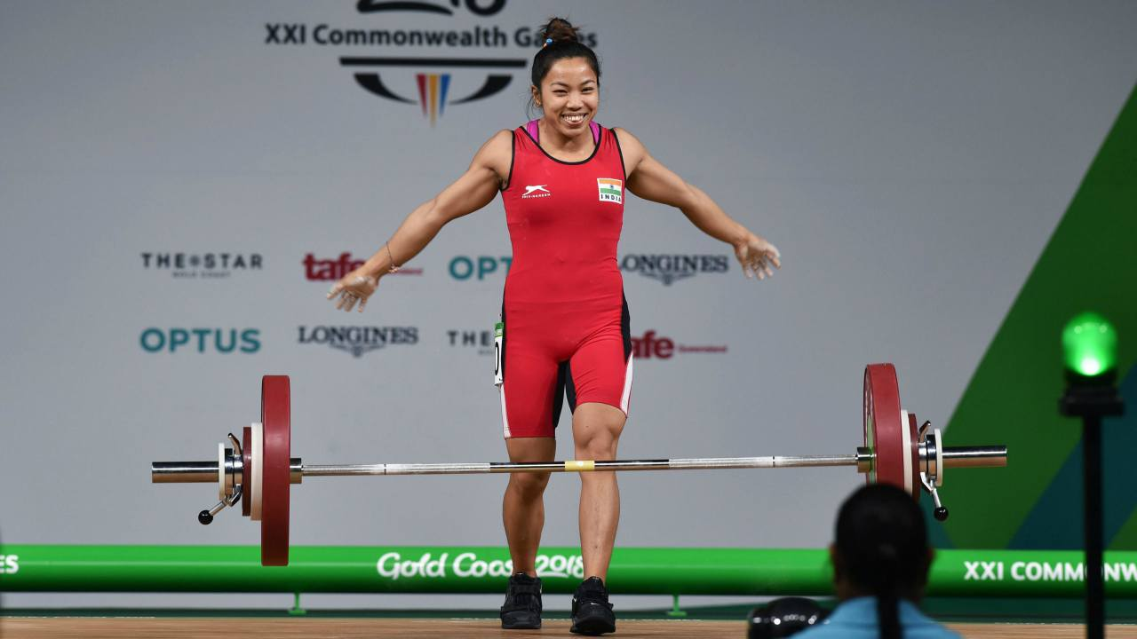 Chanu Saikhom Mirabai | India got their first yellow metal of the Commonwealth Games 2018 when this diminutive weightlifter from Manipur in each of her six lifts smashed Games records. She, participating in 48 kg category, lifted 196kg (86kg in Snatch + 110kg in Clean and Jerk) bagging the gold medal.