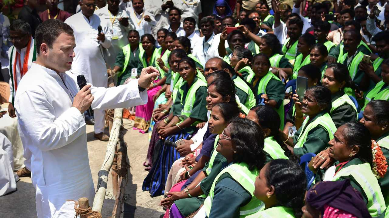 Congress President Rahul Gandhi interacting with 'pourakarmikas' on the last day of his Jana Aashirwada Yatra in  Bengaluru on 8th April 2018.  (PTI Photo)
