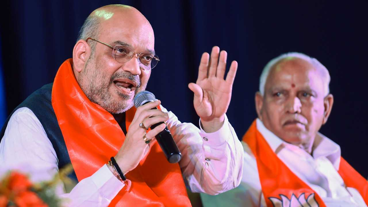 BJP chief Amit Shah and B S Yeddyurappa interacting with entrepreneurs ahead of Karnataka Assembly Elections in Bengaluru on 19th April 2018. (PTI Photo)