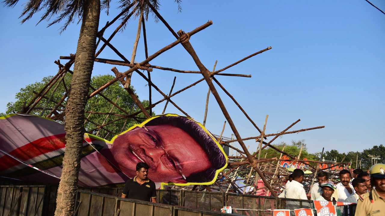 Cut-out of Karnataka Chief Minister Siddaramaiah collapse during a public rally of Congress president Rahul Gandhi in Bengaluru on 8th April 2018. (PTI Photo)