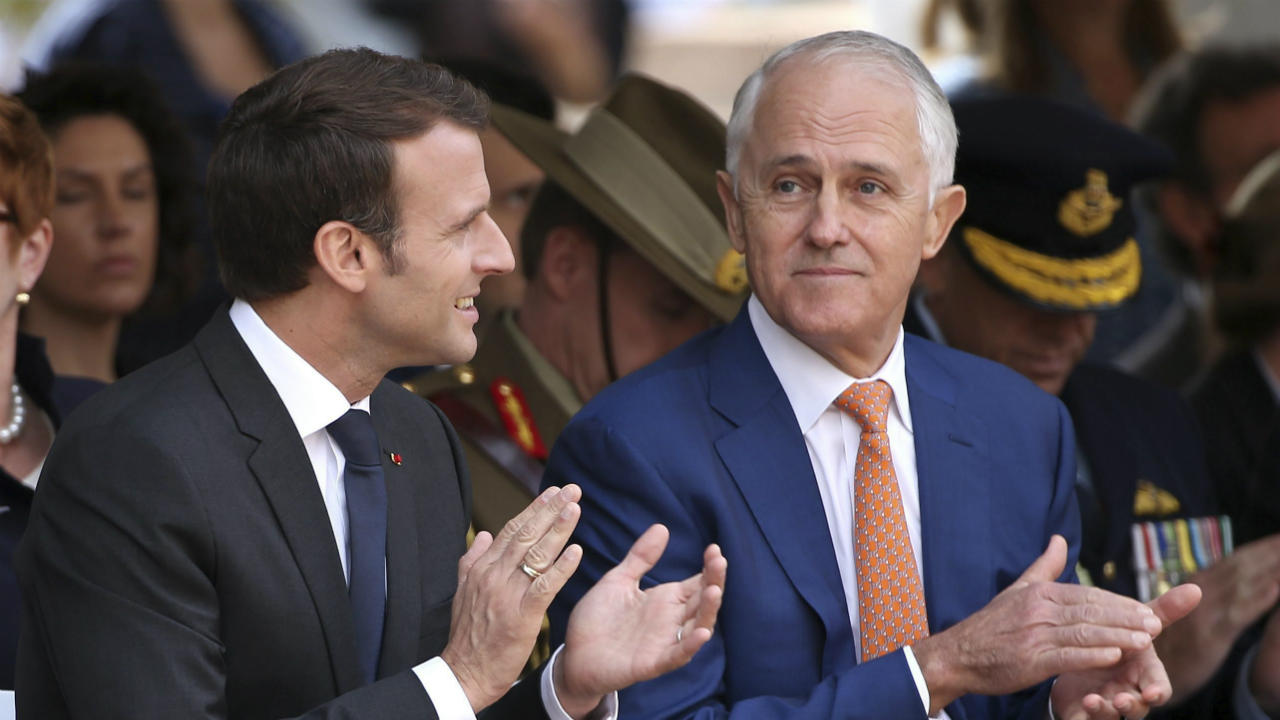 French President Emmanuel Macron, left, and Australian Prime Minister Malcolm Turnbull clap during a war commemorative ceremony in Sydney. Macron is on a three-day visit to Australia. (AP/PTI)