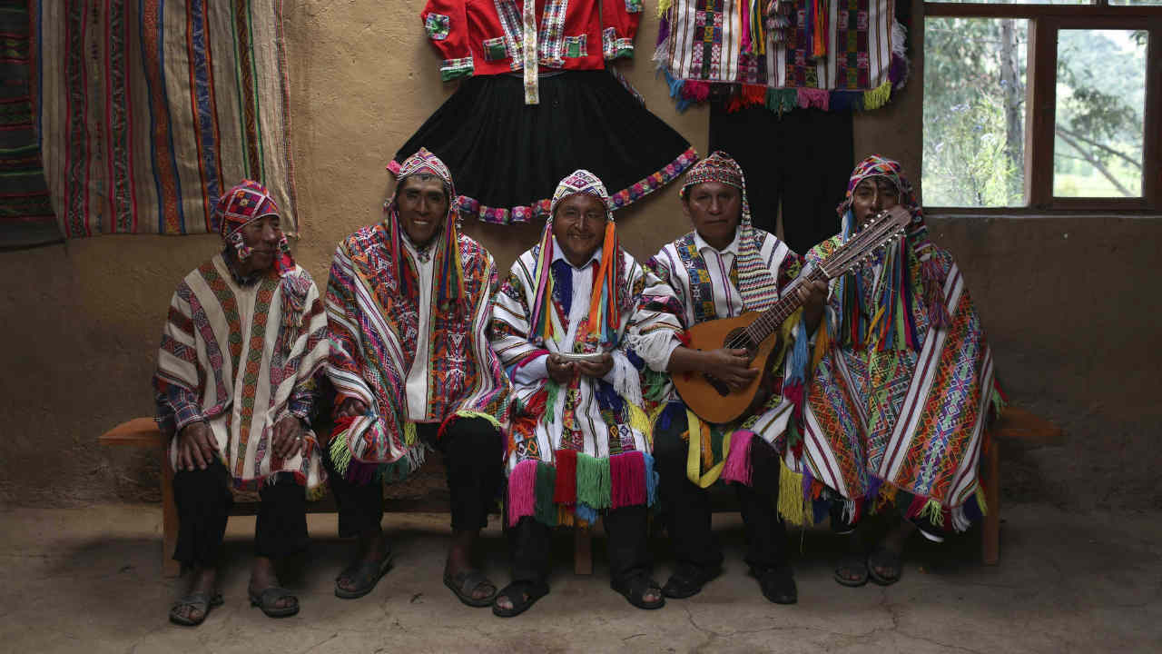 A group of musicians pose for a portrait in Pitumarca, Peru, near Rainbow Mountain where tourists are stunned by the magical beauty of the stripes of turquoise, lavender and gold that blanket the mountain. (AP/PTI)