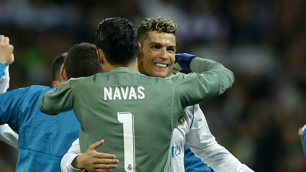 Real Madrid's goalkeeper Keylor Navas, left, hugs his teammate Cristiano Ronaldo, right, after advancing to the final when playing 2-2 during the Champions League semifinal second leg soccer match between Real Madrid and FC Bayern Munich at the Santiago Bernabeu stadium in Madrid, Spain. (AP/PTI)