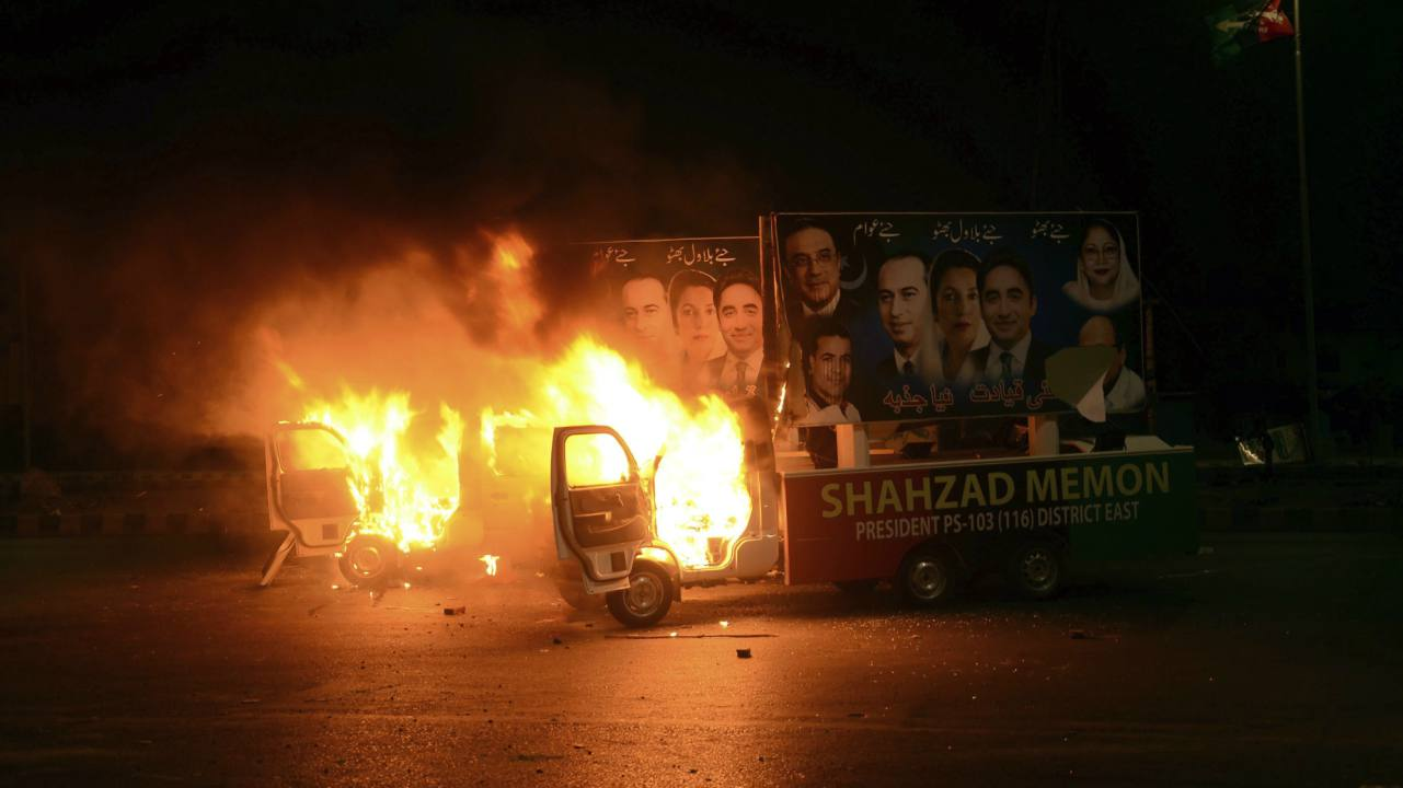A vies of vehicles set on fire by political workers during a clash in Karachi, Pakistan. Workers of the Pakistan Peoples Party and Pakistan Tehreek-e-Insaf had resorted to violence over a venue dispute for their election rallies, leaving many injured. (AP/PTI)