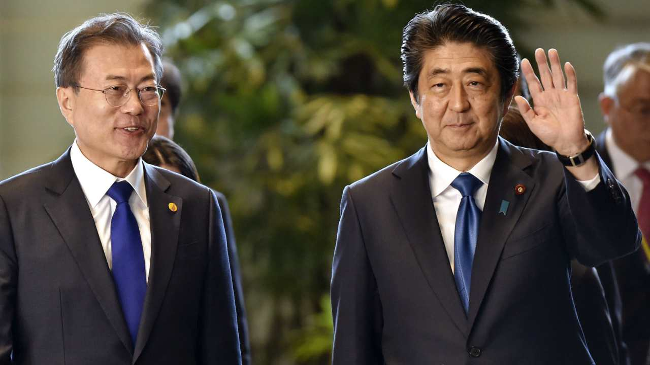 South Korea's President Moon Jae-in, left, is greeted by Japan's Prime Minister Shinzo Abe prior to their meeting at Abe's official residence in Tokyo. (AP/PTI)