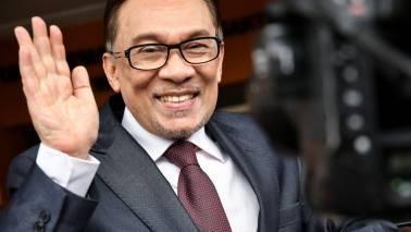Malaysia's jailed politician Anwar Ibrahim walks free following pardon