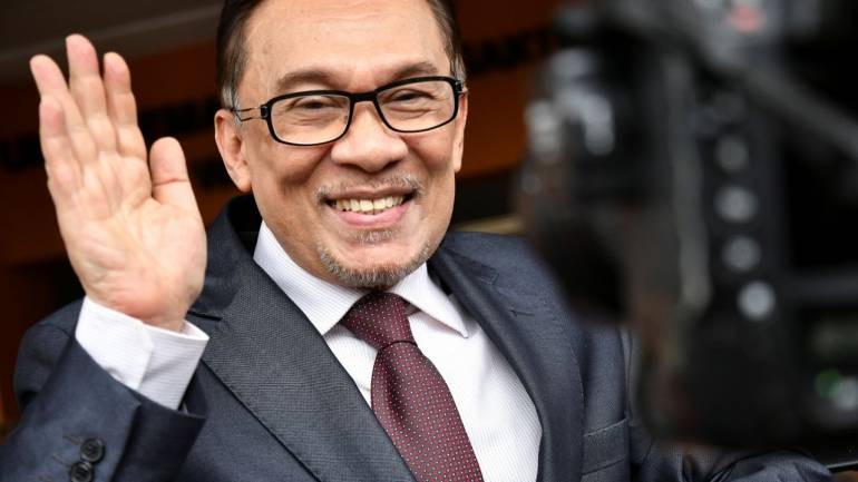 malaysia s jailed politician anwar ibrahim walks free following