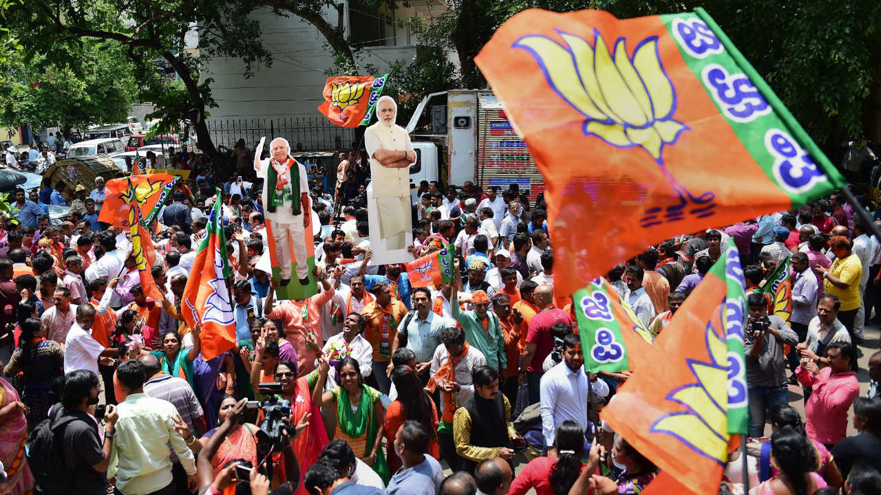 Celebrations began at the BJP headquarters in Bengaluru as well, and party cadres were of the view that the saffron party would obtain majority and form the government. (Image: PTI)