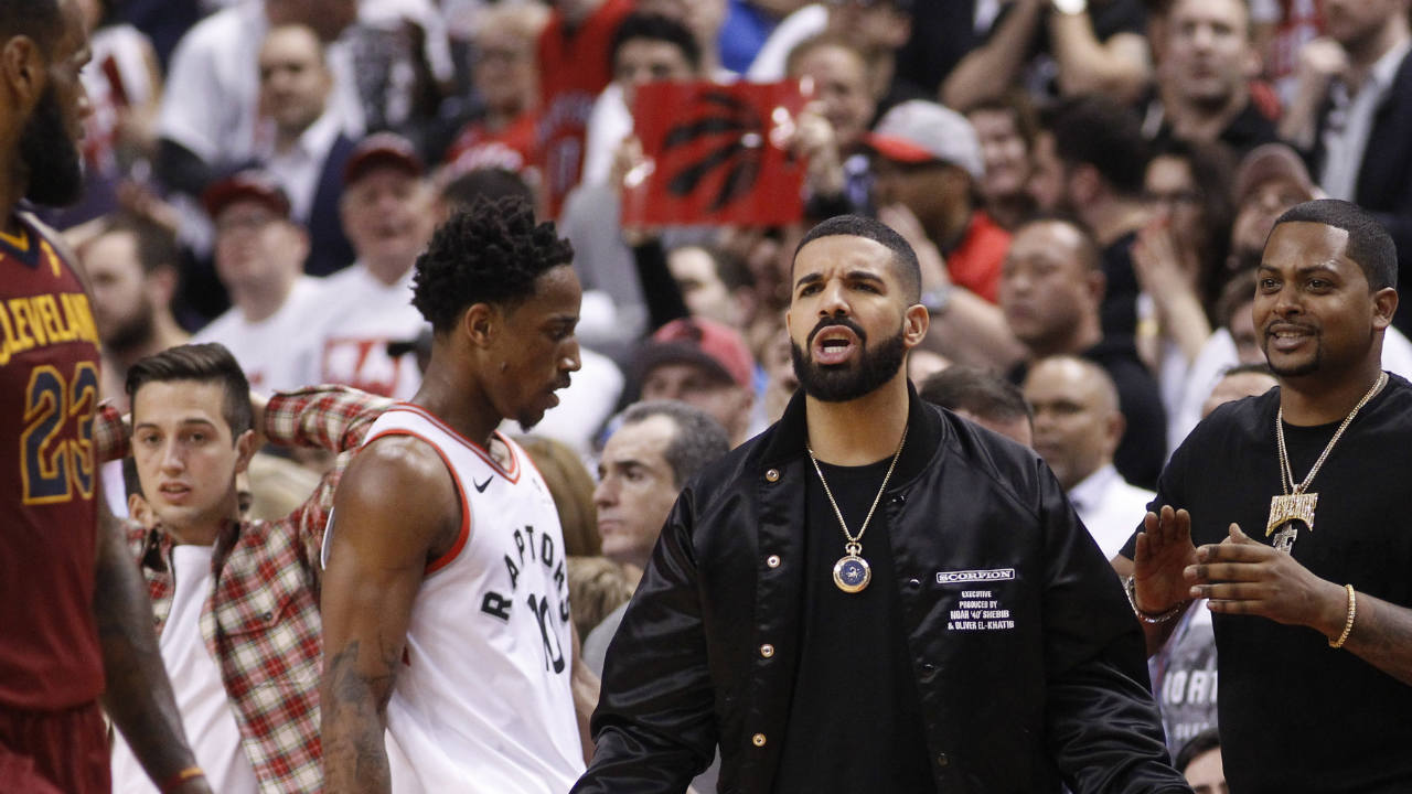 Canadian recording artist Drake talks to Cleveland Cavaliers forward LeBron James (23) during game one of the second round of the 2018 NBA Playoffs against the Toronto Raptors at Air Canada Centre. Cleveland defeated Toronto in overtime. (Reuters)
